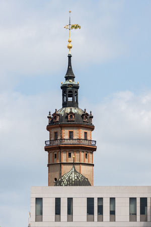 significantly: Tower of St. Nicholas Church in Leipzig with a modern building in the foreground