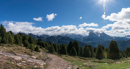 cir: Panoramic view of Rasciesa in south tyrol Italy with rocks and trail.