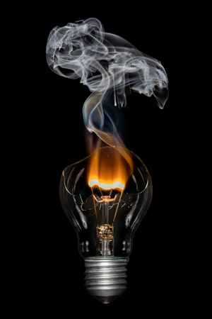 Broken light  bulb with flame and smoke