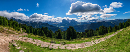 cir: Panoramic view of Raschoetz in south tirol Italy with rocks and trail. Stock Photo