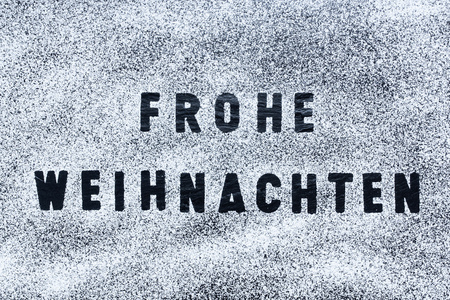 frohe: Dark grey  black slate texture, floortile, wallpaper or background. Rough texture with fine details and Frohe Weihnachten and snow.