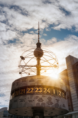 Television Tower and World Clock at Alexanderplatz in Berlin at Sunset