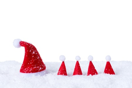Christmas hats in front of snow isolated on white background.