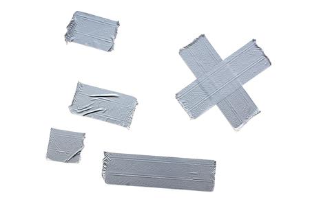 Diferentes franjas de cinta adhesiva. Todo aislado en un fondo blanco. Foto de archivo