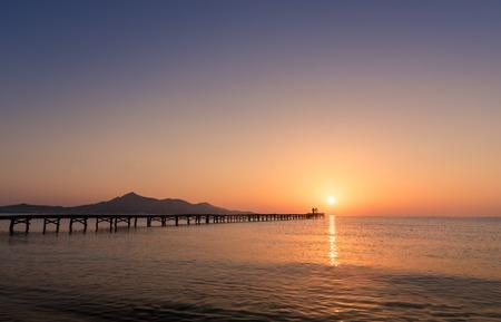 Majorca Muro beach sunrise in Alcudia Bay Mallorca at Balearic Islands of Spain. Imagens