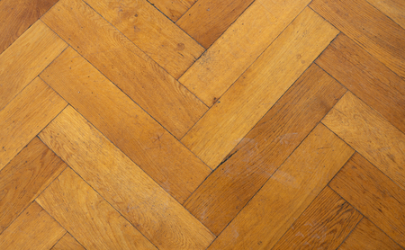 wooden floor background - herringbone parquet background
