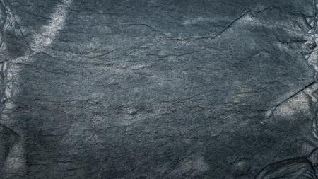 Struttura, pavimento, carta da parati o fondo dell'ardesia nera grigio scuro. Texture ruvida con dettagli fini.