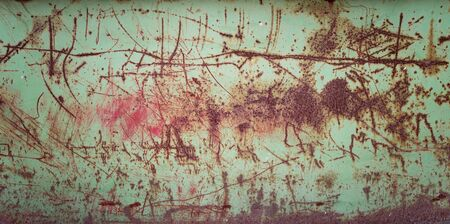 Grunge texture of green rusty metal with scratches