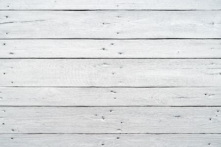 White wood planks texture with natural patterns background