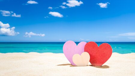 Three hearts on the summer beach - Family Vacation concept Imagens