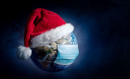 Earth With Surgical Mask and Santa Hat - Virus Infection Covid 19 - World with Coronavirus - Christmas Concept 3D Illustration Stock Photo