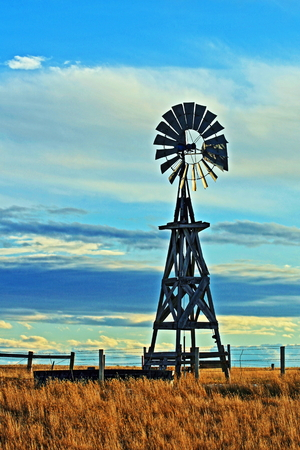 Windmill against blue cloudy sky in Lusk Wyoming in the western USA