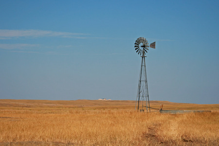 Windmill pumping water in Fairburn South Dakota between the east side of the Black Hills and the South Dakota Badlands Stock Photo