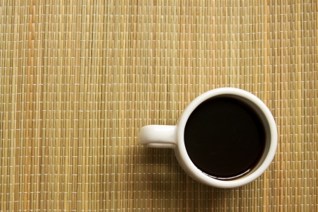 Coffee cup on straw background photo