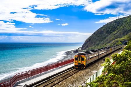 rail cross: Train on the railway in Taiwan Editorial