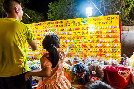 kenting: Kenting, Taiwan - JULY 15, 2015: Vendor prepares food at the Kenting main street night market located in Pingtung County.