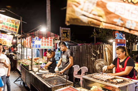 kenting: Kenting, Taiwan - JULY 15, 2015: Vendor prepares food at the Kenting main street night market located in Pingtung County.