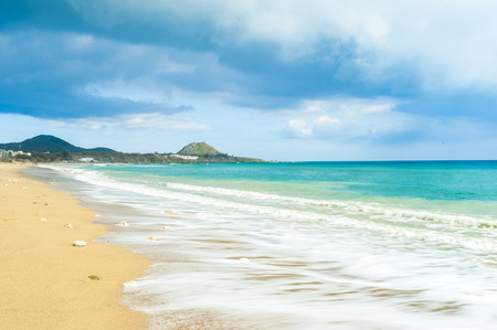 resort beach: Soft wave of the sea on the sandy beach Stock Photo
