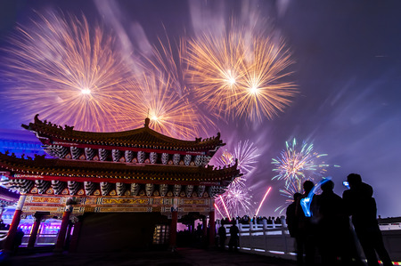 taiwan: holiday firework over a temple