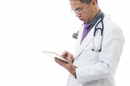electronic organiser: Doctor using a digital tablet on white background