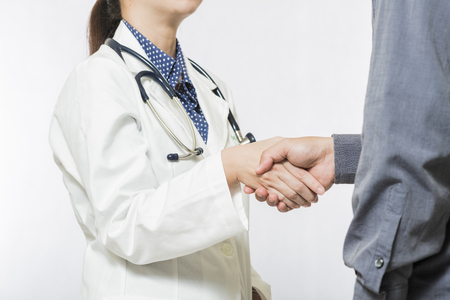 carefully: Hand of medical doctor carefully greeting or meeting patients hands