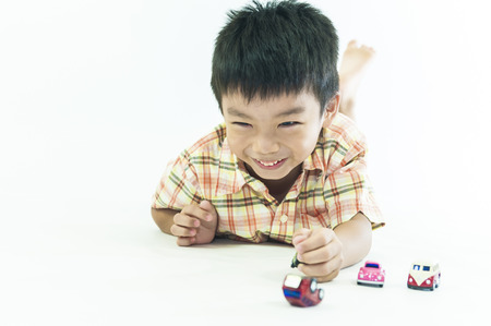 children at play: One children boys play toy cars