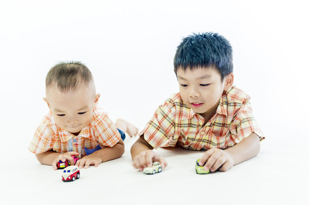 children at play: two children boys play together Stock Photo