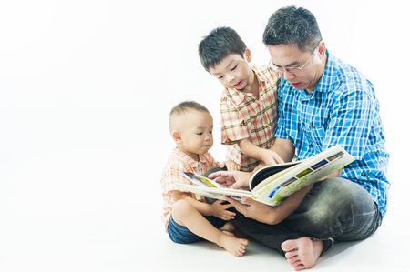 father reading book to kids, family leisure