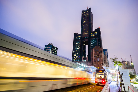 Kaohsiung, Taiwan - November 25 : View of light rail tram and the skyline in Kaohsiung, Taiwan on November 25, 2016. The light rail system in Kaohsiung is the first light rail transit in Taiwan. Editorial