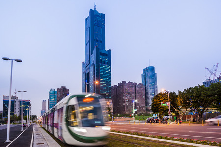 emerging markets: Kaohsiung, Taiwan - November 25 : View of light rail tram and the skyline in Kaohsiung, Taiwan on November 25, 2016. The light rail system in Kaohsiung is the first light rail transit in Taiwan. Editorial