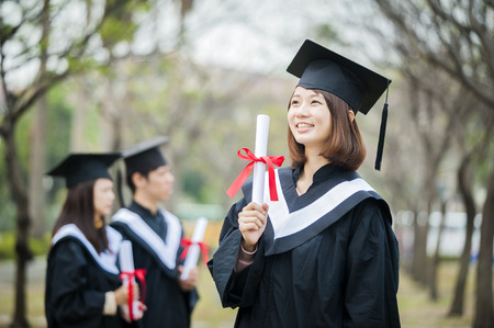 master degree: Group of successful students on their graduation day Stock Photo