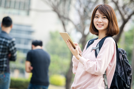 woman using a tablet pc at outdoor