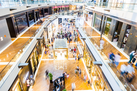 SINGAPORE - August 23: Timelapse in motion - inside view in the shopping mall The Shoppe at Marina Bay Sands on August 23, 2017 in Singapore. Editorial