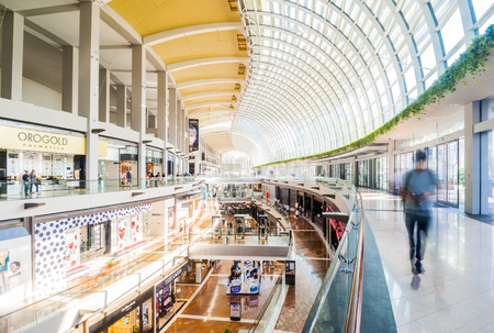 SINGAPORE - CIRCA AUG 2017: Luxury expensive brands shops promenade and customer inside of modern huge shopping mall The Shoppes at Marina Bay Sands