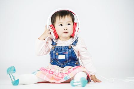 Children listen to music on a white background Stock Photo