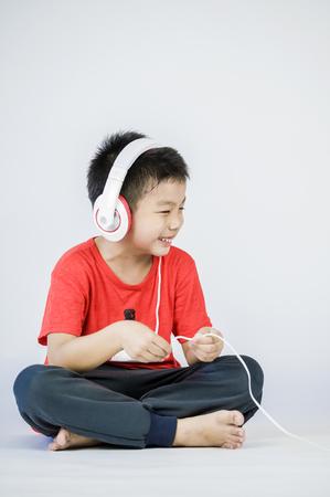 Boy listen to music on a white background Stock Photo