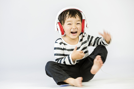 Boy listen to music on a white background Stock Photo