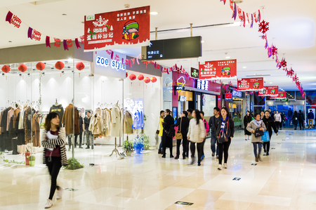 CHINA - January 23: Slightly defocused crowd of walking people in the newly opened shopping mall center on January 23, 2018 in China. Editorial