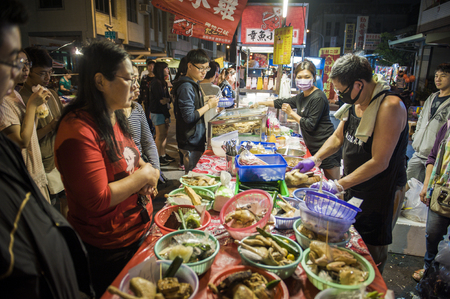 TAIWAN, KAOHSIUNG - 29 March 2018.The Liuhe Night Market tourist night market in Xinxing District in one of the most popular markets in Taiwan where seafood, handicrafts, clothing and food is sold.