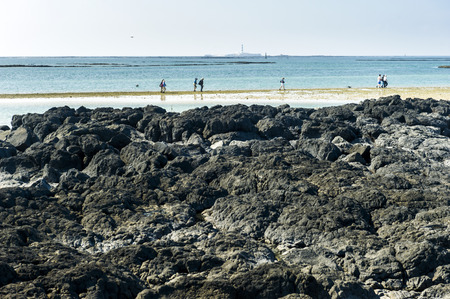 Penghu Taiwan Reef extends the seaside, with pure white clean beaches and blue sky and white clouds. Stock Photo