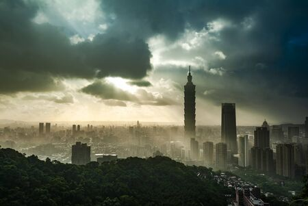Skyline view of Taipei glowing in the sunset light Stock Photo