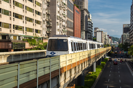 Taipei, Taiwan - July 27, 2019 : Taipei Metro Wenhu Line (Known as The Muzha Line Before Oct, 8, 2009). The Train Runs on Elevated Rails While Other Cars Jammed on The Roads.