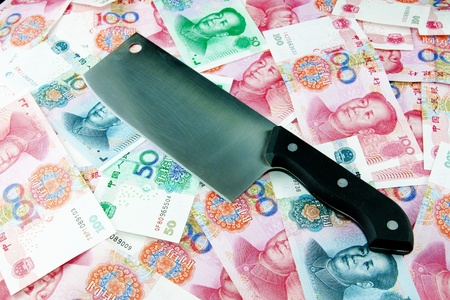 Renminbi and knife,This works for all sorts of illegal activities Stock Photo - 12936695