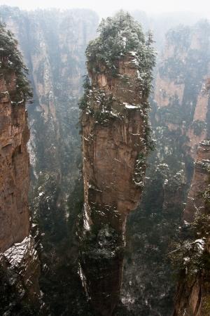 quartzite: zhangjiajie national park in winter with snow and fog,Hunan China