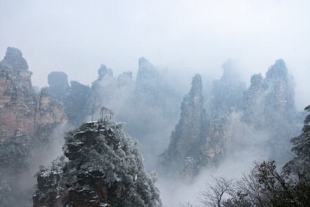 hallelujah: zhangjiajie national park in winter with snow and fog,Hunan China