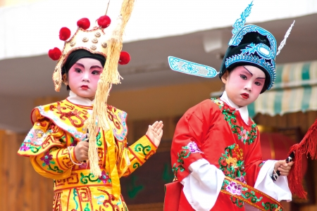 Unidentified child actors on a traditional parade , It is a non material cultural heritage,celebrating Chinese New Year