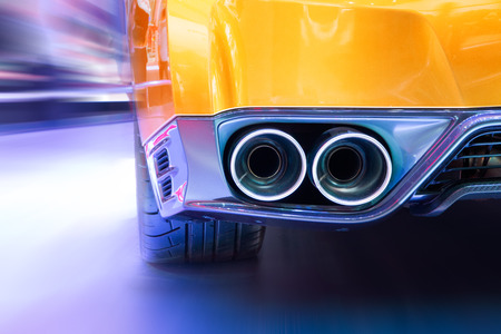 Double exhaust pipes of a sports car photo