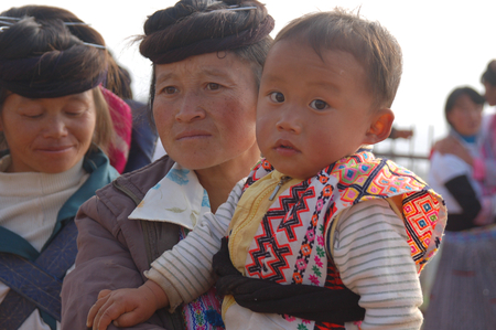 motherly love: Mother and son of Miao nationality, Kunming, China