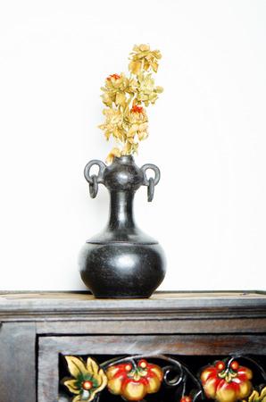dried flower arrangement: Black pottery vase