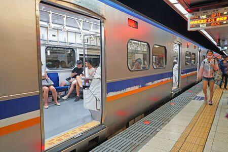 Taipei, Taiwan - July 28, 2019 : Passengers waiting for subway at Taipei main metro station subway. Stock Photo